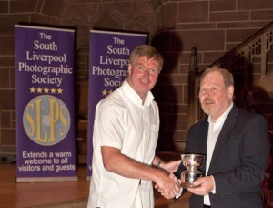 Sean receiving his awards from Roger Phillips