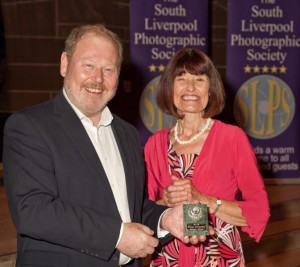 Barbara Green receiving her award from Roger Phillips
