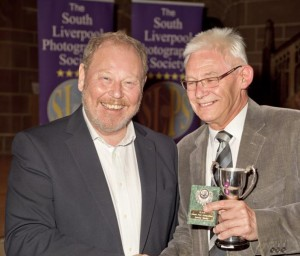 Tony Myers FRPS receiving his awards from Roger Phillips