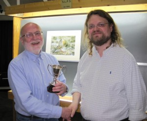 Noel George receiving the Best print award for 'Ortolan Bunting Preening' from Adrian Lines, on behalf of Margaret Sixsmith from Hoylake PS