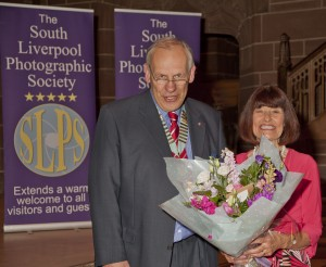 Martin presents a bouquet to Barbara Green in thanks for MC ing the evening.