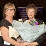 Mrs Mullarkey receiving flowers from Irene