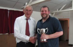 Stuart receiving his trophy from Gordon Jenkins