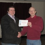 Brian Johnson receiving his Commended certificate from Tremaine Cornish