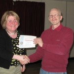 Catherine Rouse receiving her Commended certificate from Tremaine Cornish