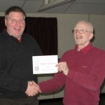 Tony Jones receiving his Highly Commended certificate from Tremaine Cornish