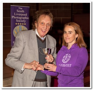 Tracey Dolan receiving the Most Improved Photographer of the Year award from Ken Dodd OBE