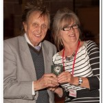 Irene Drummond receiving her hard earned reward from Ken Dodd OBE