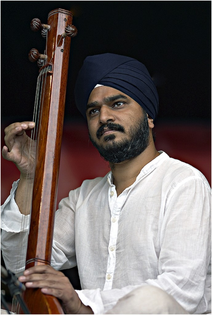 """George Singh"". This picture was taken at Chevasse Park on 13th August 2003 during the Mathew Street Festival. He was playing with the famous sitar player Shalil Shankar. This Print was placed first in the portrait category at the Annual Competition in 2004."