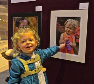 """That me, cheese!""   The lovely little Lucy, proud to show her portrait taken by Grandad Paddy Green from SLPS."