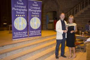Irene Drummond receiving her award from Eamonn McCabe