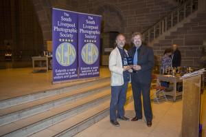Paul Matthews  receiving his award from Eamonn McCabe