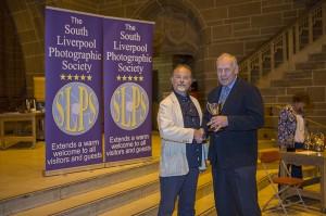 Martin Reece receiving his award from Eamonn McCabe