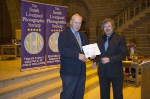 Martin Reece, OBE ARPS, receiving his Lifetime Membership award from President, Paul Matthews