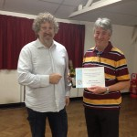 Mike Lawson  receiving his SLPS Exhibition 2014 Peoples Choice Award  certificate.