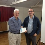 Tom Kipping receiving his Best Colour Print certificate.