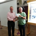 Simon Rahilly receiving his two award certificates for his two winning panels