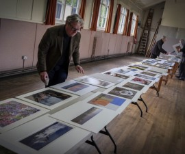 Paul Gallagher studying the colour prints during his judging of our Annual Exhibition Competition.