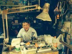 Camera repairs on the streets of Da Nang Vietnam by Irene Drummond