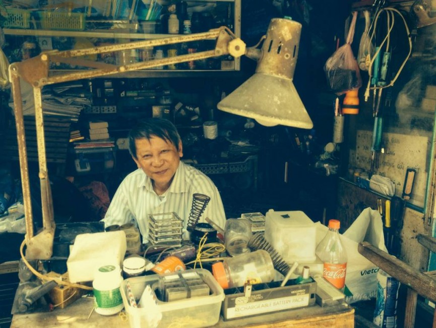 Camera repairs on the streets of Da Nang Vietnam by Irene Drummond