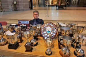 Tim Evans, polisher and keeper of the trophies!