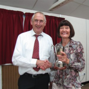 Barbara Green receiving her trophy from Gordon Jenkins