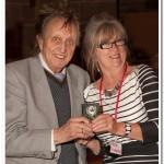 Irene Drummond receiving her hard earned reward from Ken Dodd OBE