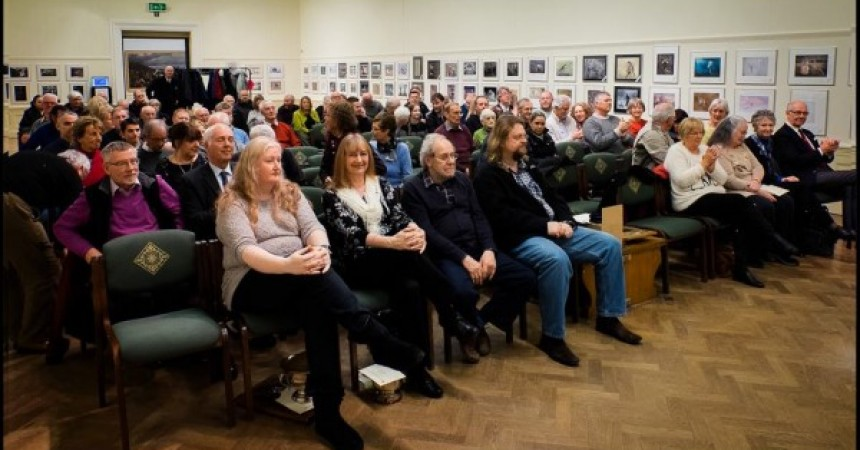 Over 80 people fought the rain to attend the opening and awards presentations.