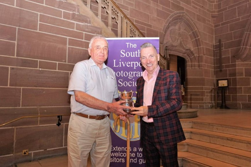 Trevor Roberts is presented with the Sid Cairns Memorial Trophy  for the winning image of the year from monthly competitions for his image 'Ewer by Jorge Jensen'