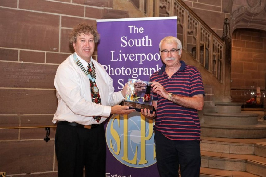 Peter Tormey, Club Secretary, is presented with the President's Award by Paul Matthews